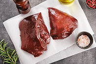 raw-cow-liver-white-paper-with-salt-pepp