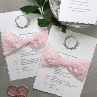 Bachelorette party invitations wrapped in pink lace