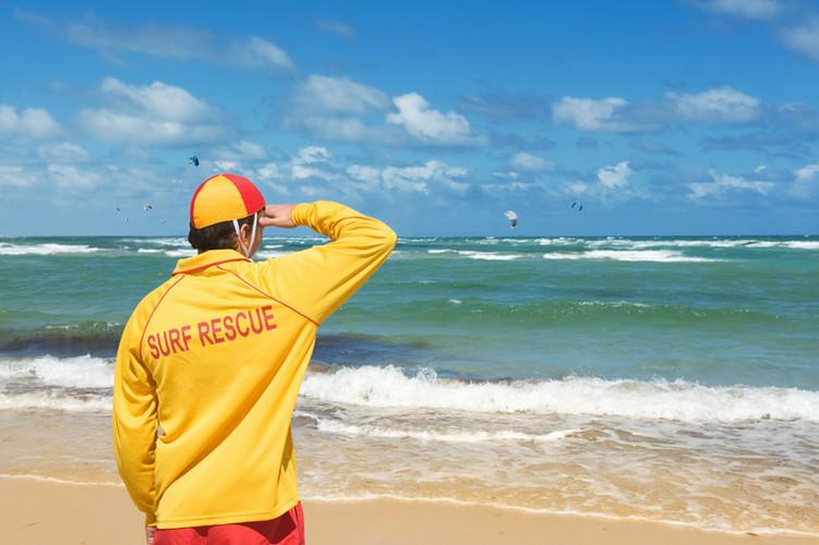 young man  lifesaver  watching the situa