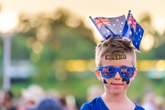 Cute Australian boy with flags and tatto