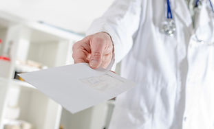 Doctor showing a letter in medical offic