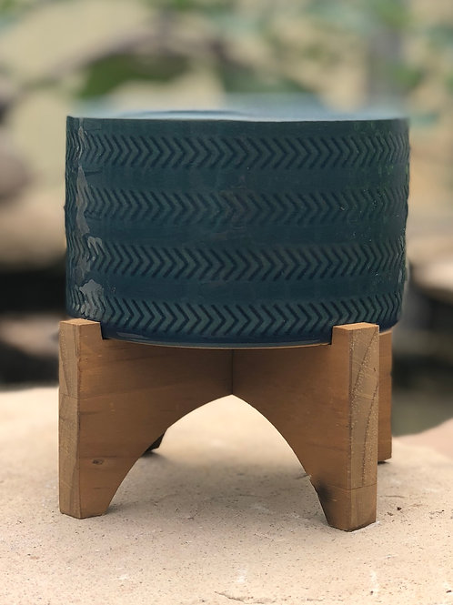 Teal blue ceramic pedestal pot