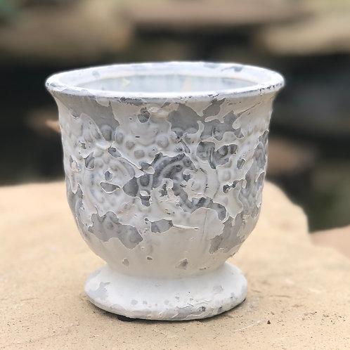 White washed urn