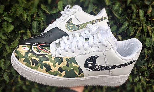 A Pair Of Hand Painted Nike Air Force 1 Lows Inspired By BAPE