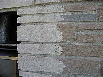 Paint coming off of brick