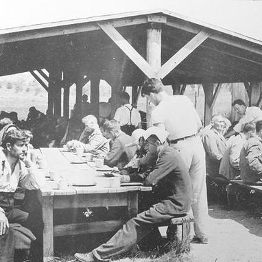 An outdoor work crew of patients breaking for lunch.