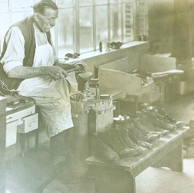 A patient-cobbler repairing shoes.