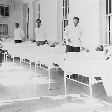 """A cira 1930s male admission ward. """"All patients on admission are out to bed for purpose of resting and relaxing until the physician prescribes otherwise"""""""