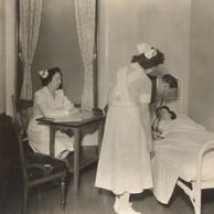 Nurses and doctor attending patient