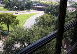 Texas School Book Depository. Oswald's 6th floor window. This window is sealed off from the public and enclosed in glass. The maintenance crew were cleaning it the day I visited and I snuck in and took this one image. The red circle is shot #1-duct tape X from the previous image.