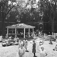 Female patients enjoying the outdoors behind the Kirkbride wings in the 1940s.