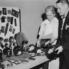 Mrs. Mildred Devereux occupational therapist, and George Apholt, hospital supervisor and Boy Scout leader. Review boy inmate's work in the children's unit. September, 1951.  © John Gray