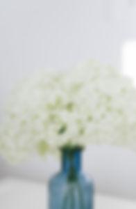 White flower in blue vase.jfif