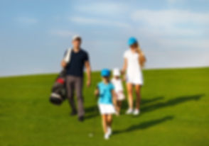 Family of golf players walking  at the c