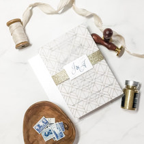 Vellum-wrapped Invitation with Deco Print and a Touch of Sparkle