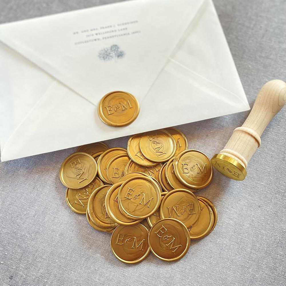 custom gold wax seal on a wedding invitation