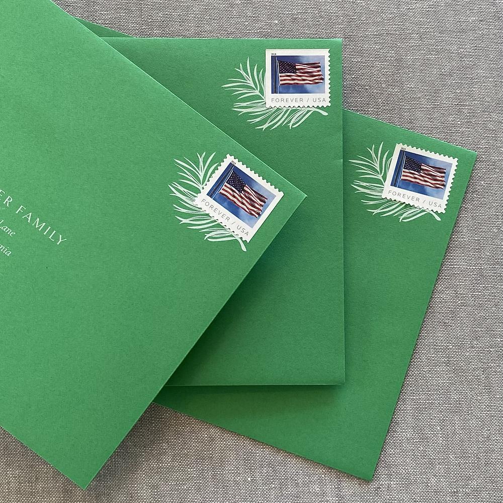 custom illustration as postage frame on green envelope
