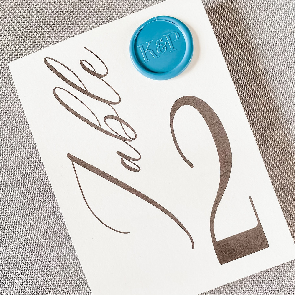 wax seal on table numbers