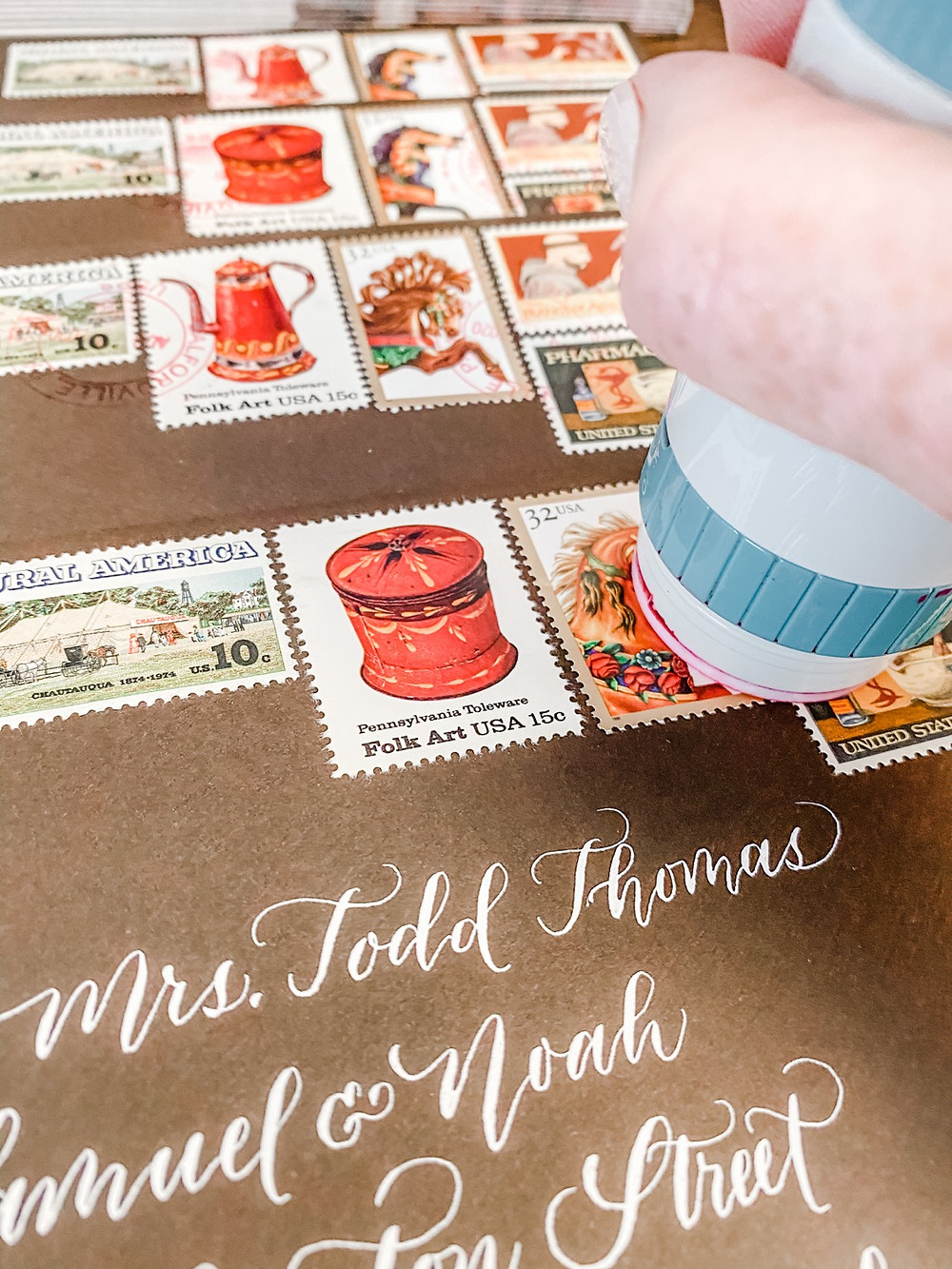 Brown envelope with Vintage Postage being hand canceled