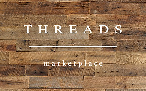 Threads - logo with wood background.png