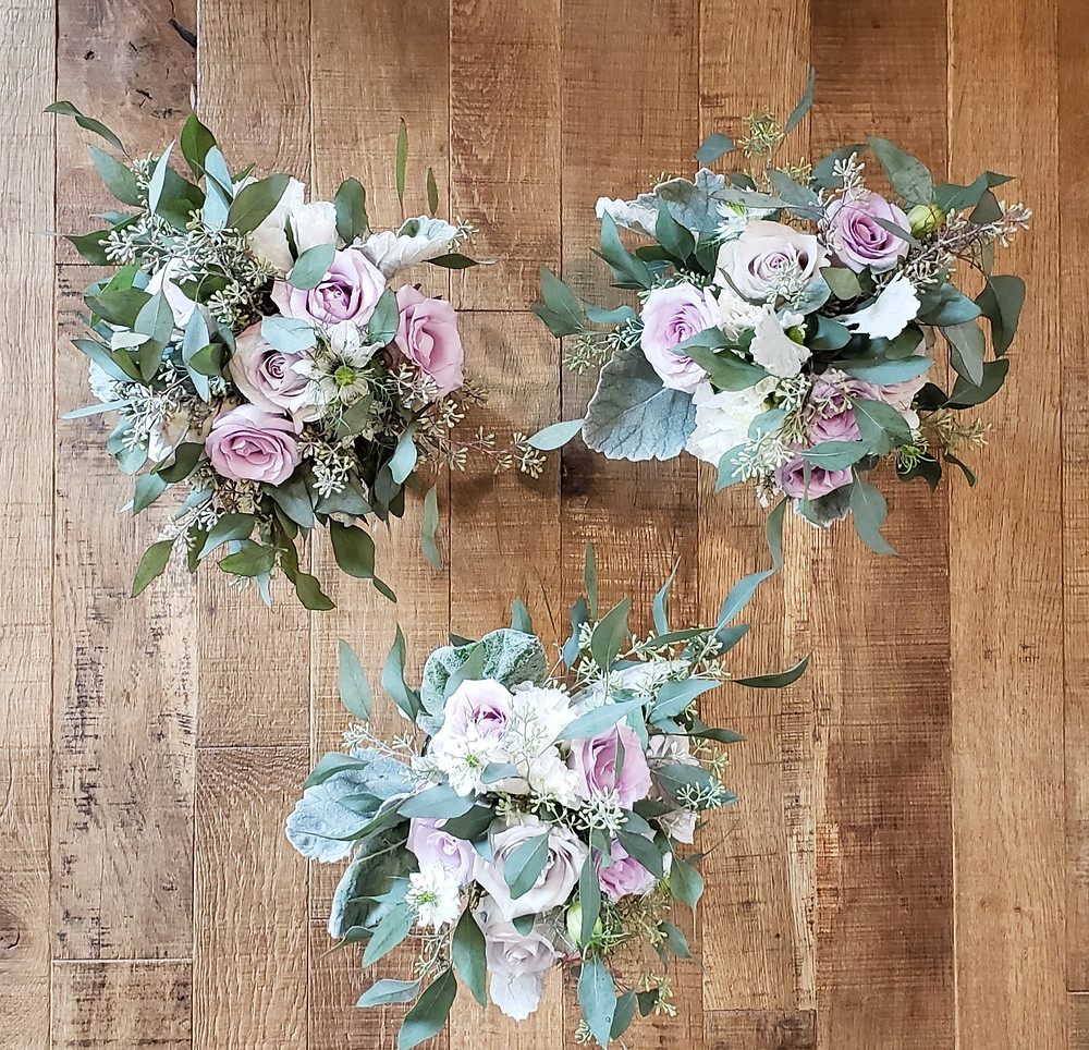 Bridesmaids Bouquets including Lavender Roses, White Lisianthus, Seeded Eucalyptus, and White Lavender.