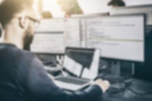 SAFEgroup Automation - Man working on a SCADA program