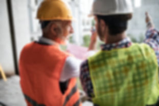 SAFEgroup Automation - Two men wearing safety gear on site