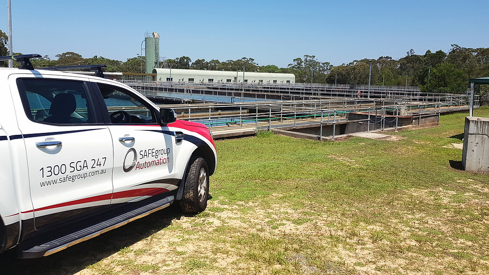 SAFEgroup Automation car parked next to a water treatment plant