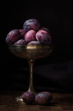 Plums in a silver cup