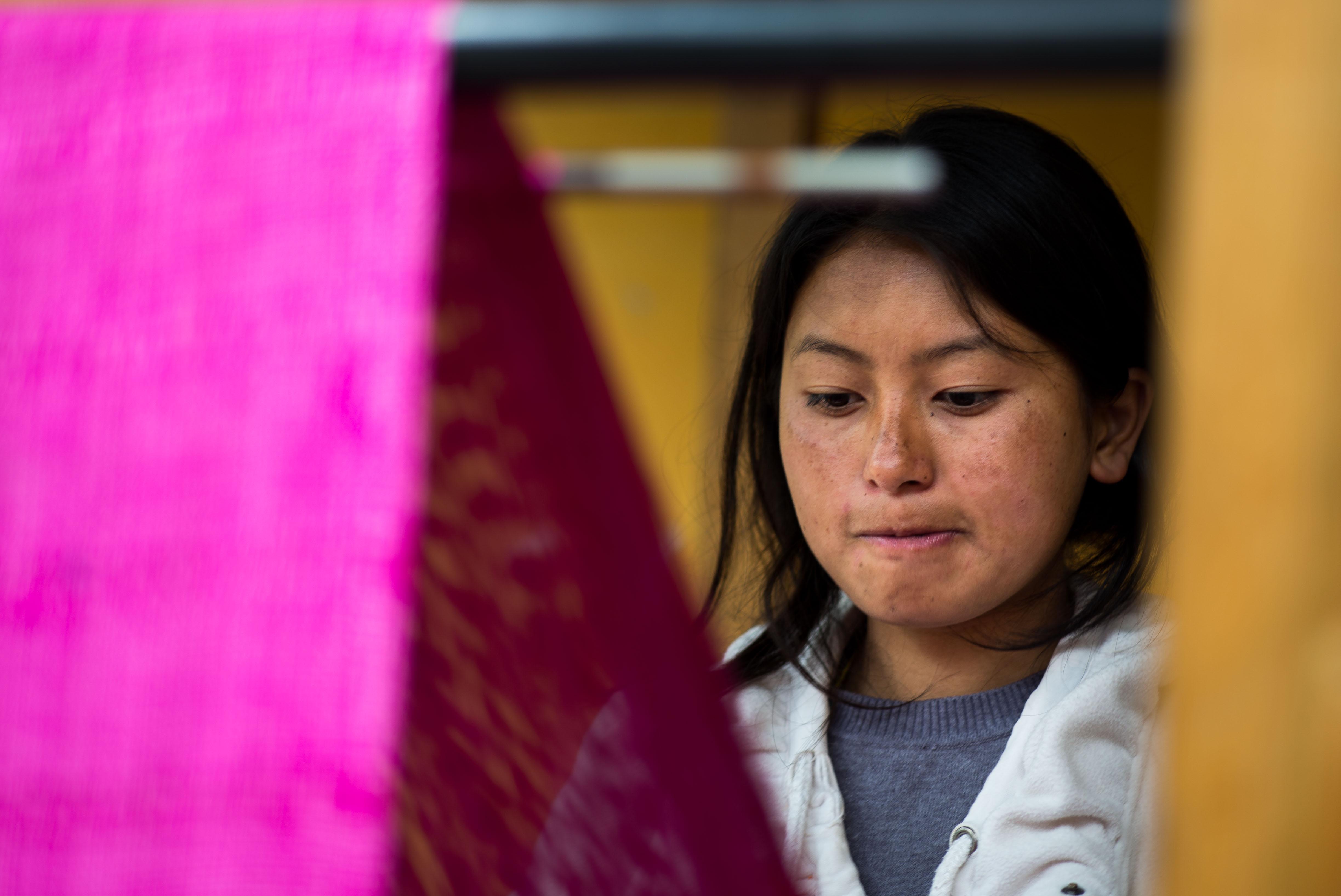 Young Bhutanese weaver