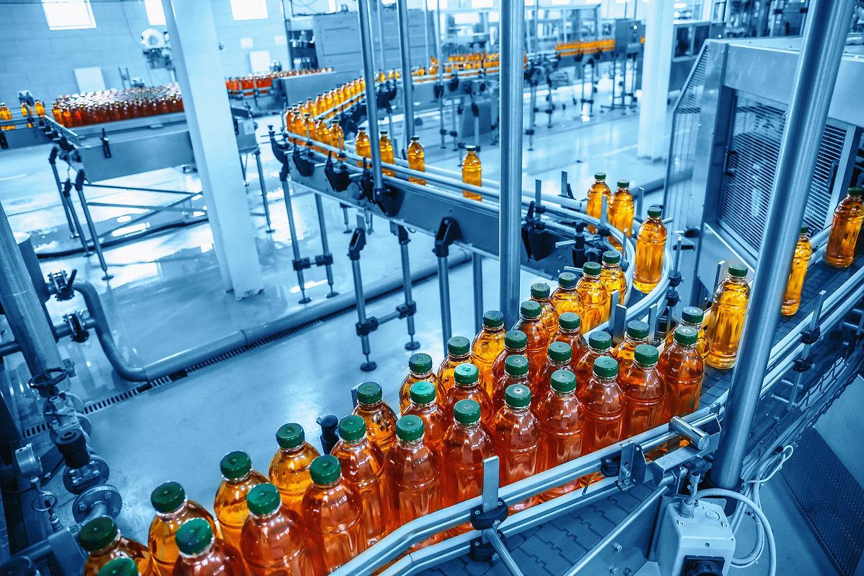 Conveyor belt, juice in bottles on bever