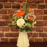 Cream jug with winter flowers.jpg