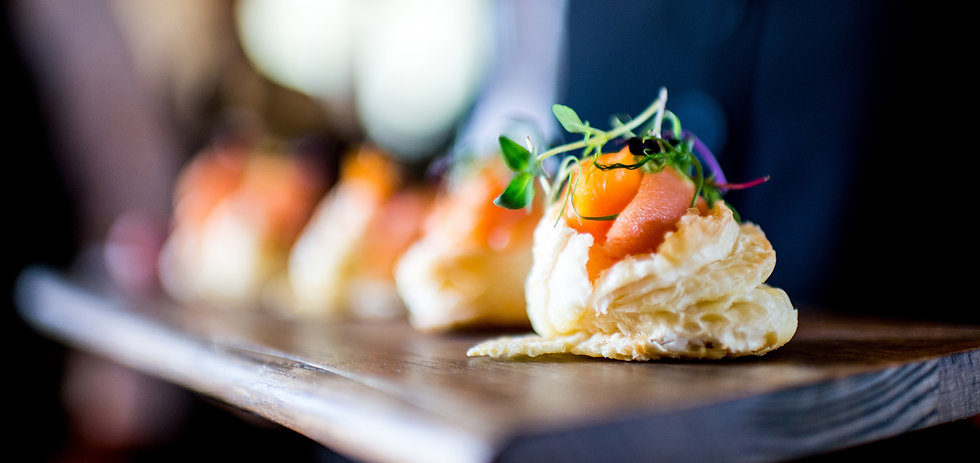 Closeup of a puff pastry and tomato appetizer with microgreens