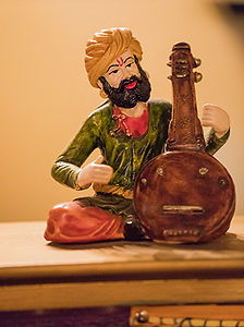 Figurine of man playing sitar
