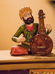 Figurine of man playing sitar