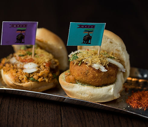 Potato dumpling slider and minced lamb slider with colorful little Mela toothpick flags