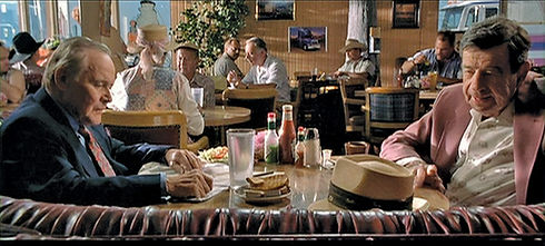 """Screenshot from the movie """"The Odd Couple,"""" featuring Walter Matthau and Jack Lemon seated in Crazy Otto's Diner"""