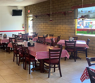 Dining area with tables with red and white checkered table cloths
