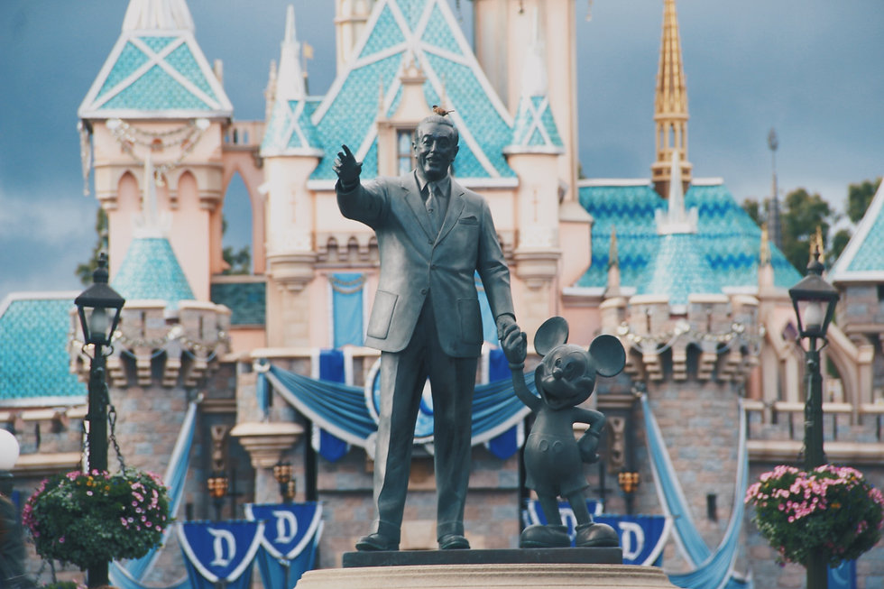 Stature of Walt Disney and Mickey Mouse outside Disneyland in California with Sleeping Beauty's Castle in the background