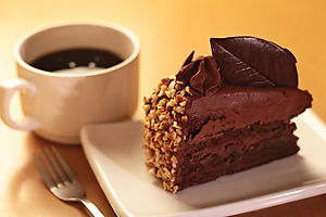 Chocolate cake with chocolate frosting and chopped nuts