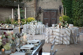 Tables set for an elegant catering event at Firestone Vineyard Courtyard
