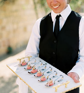 Server with a tray of appetizers at a corporate event