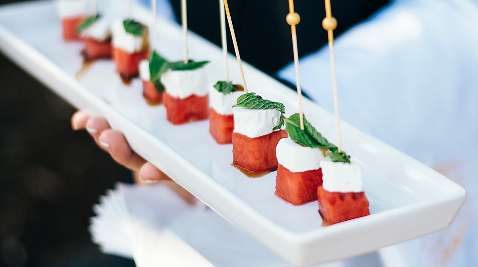 Appetizer tray of skewered watermelon, light cheese and mint