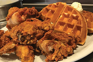Crispy chicken and waffles with butter and syrup