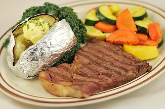 Top sirloin with sauteed vegetables and a baked potato