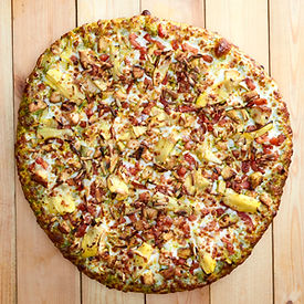 Overhead View of a Medium Size Chicken Pesto Pizza