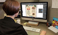 Person designing a menu on computer