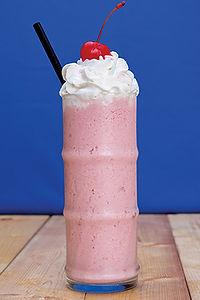 Fruit Smoothie with whipped cream and a cherry