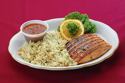A fillet of grilled salmon basted with Brad's special sauce, with BBQ beans and rice