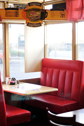 Red seat booth by the window